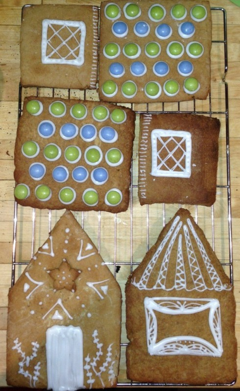 christmas gingerbread house pieces ready to assemble decorate with white royal icing