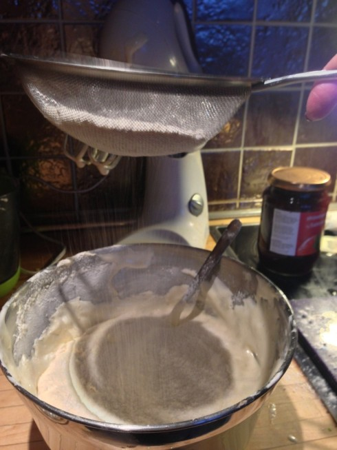 sieving sifting flour action shot fold with metal spoon swiss roll recipe