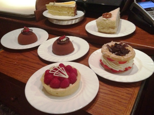 chocolate bomb engadine torte raspberry white chocolate tart strawberry paris-brest cakes at bettys tea room cafe yrok