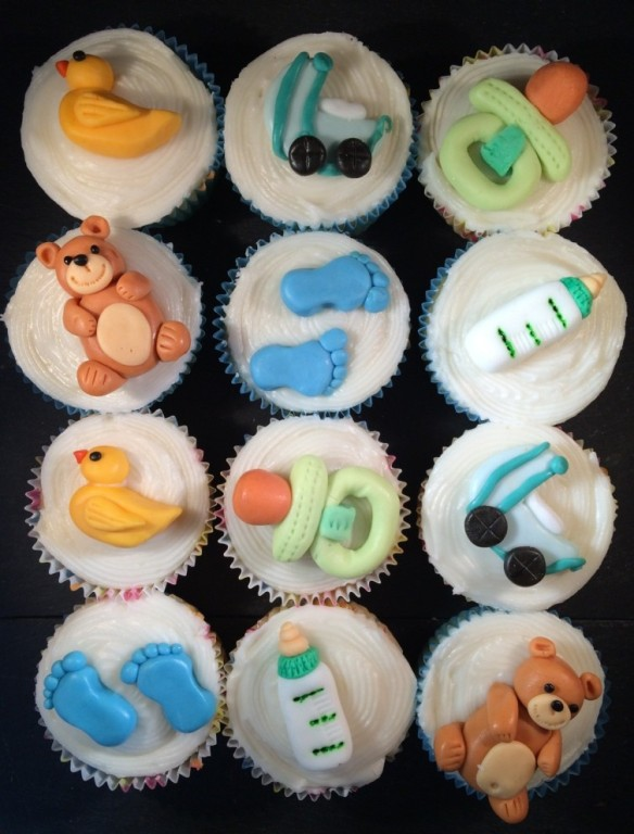 baby showe cupcakes different themed toppers