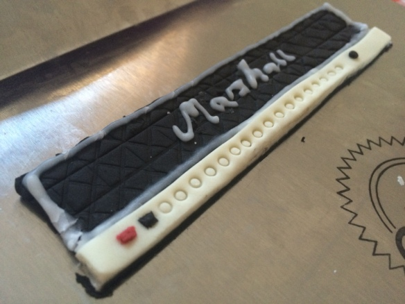 marshall amp front buttons and piped logo made from icing