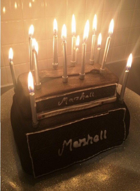 marshall amp stack birthday cake lit with candles