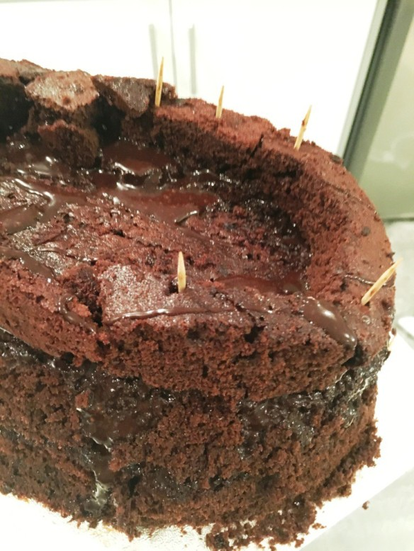assembling layers of chocolate maderia cake for creme egg cake giant easy recipe
