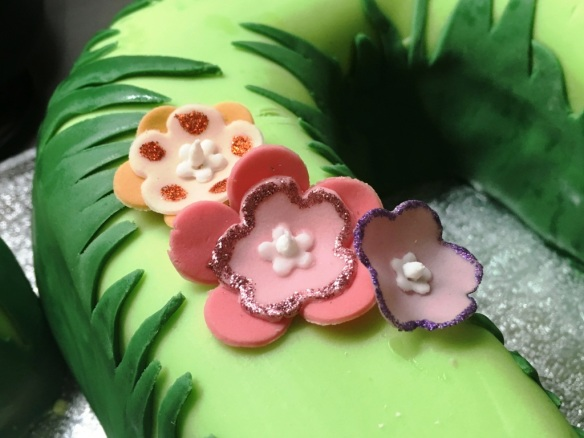 edible glitter purple orange and pink flowers handmade fondant icing