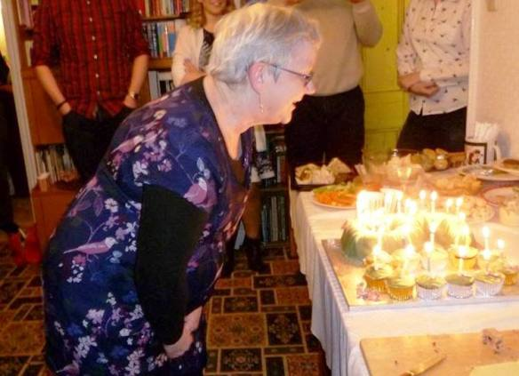 happy 60th birthday mum blowing out candles on cake